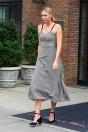 Maria Sharapova paired her cute frock with block-heeled ankle-strap pumps.