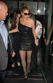 Mariah Carey was a knockout in a black leather one-shoulder dress while dining at Mr. Chow.