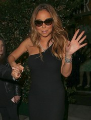 Mariah Carey put on a pair of cateye sunglasses while facing paparazzi outside Mr. Chow.