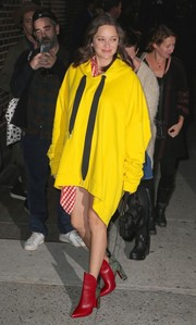 Marion Cotillard was hard to miss in her oversized bright-yellow Marques ' Almeida hoodie while headed to the 'Stephen Colbert Show.'