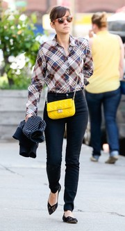 Marion Cotillard accessorized with a bright yellow Dior bag for a blast of color to her look.