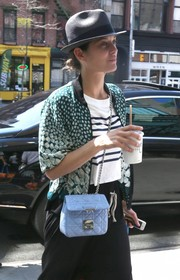 Marion Cotillard took a stroll in New York City carrying a quilted baby-blue shoulder bag by Dior.