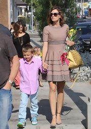 Rhea Durham wore a pair of nude pumps while out with family.