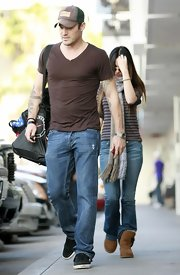 Megan Fox paired a t-shirt, jeans and a woolen scarf with a pair of ultra comfy boots while out in Hollywood.