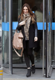 Mel C kept warm in style with a black leather-panel coat during a visit to the ITV Studios.