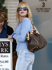 Melanie Griffith added a luxe touch to her daytime attire with a classic monogrammed Louis Vuitton shoulder bag.