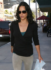 Michelle Rodriguez was casual yet chic in a black wrap top and gray pants while out and about in Beverly Hills.