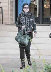 Michelle Trachtenberg kept warm with a black-and-white leather jacket teamed with a leopard-print scarf for a day of shopping in Beverly Hills.