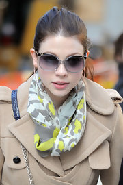 Michelle Trachtenberg went for an old school look in clear cateye sunglasses straps.