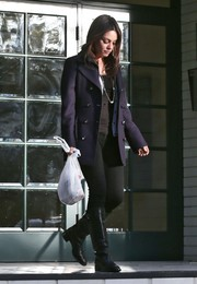 Mila Kunis teamed a navy pea coat with black jeans for a day out in LA.