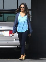 Mila Kunis opted to roll up her dark skinny jeans for a trip to the salon.