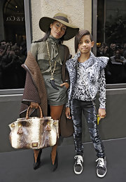 Jada paired her army green ensemble with a snakeskin print shoulder bag.