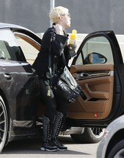 Miley Cyrus attended a business meeting wearing a pair of Chanel tweed sneaker boots.