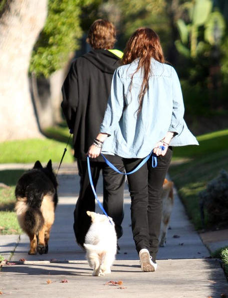 Billy Ray Cyrus And Miley Cyrus Out Walking Their Dogs