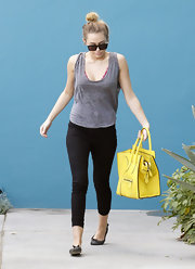 Miley Cyrus brightened up her gym style with a canary yellow tote.