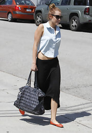 Miley Cyrus made this button-down look casual with her maxi-skirt and flats.