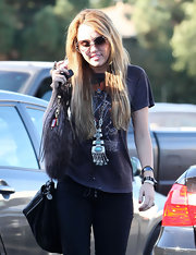 Miley Cyrus finished off her look with a wrist full of bangles.