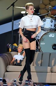 Miley showed off some skin with these black bootie shorts.