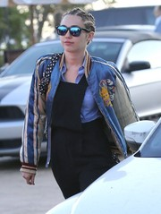 Miley Cyrus was spotted out in Malibu wearing a vintage track jacket over black overalls.