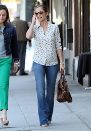 Minka Kelly added girlish whimsy to her street style with a dotted blouse.