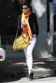 Actress Mini Driver was seen leaving a restaurant in LA donning an on trend fringe shoulder bag.Fringe is one of the hottest embellishments for the spring and she showed us a great way to make it work.
