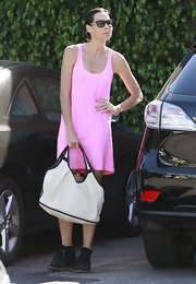 Minnie Driver stuck to a summery look when she wore this bubblegum pink tank mini dress.