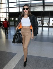 Miranda Kerr donned a white crop top for a fitted look.