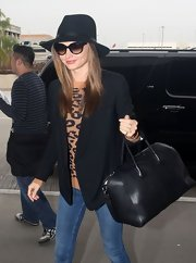 Miranda looked so cute in her fitted blazer for her trip to LAX.
