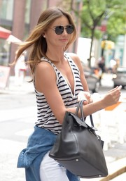 Miranda Kerr stepped out in NYC rocking a pair of round shades by Prada.