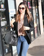 Miranda tossed on a black blazer over her jeans for a spa trip in Hollywood.