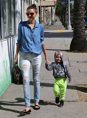 Miranda Kerr chose a pair of light-wash skinny jeans for her casual but chic look while out with her son, Flynn.