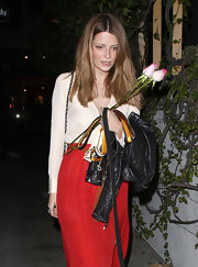 Mischa Barton embodied '70s glam in a silky ivory blouse tucked into a high-waist crimson skirt.