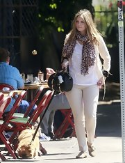 Mischa spiced up her cream and white outfit with a bold leopard-scarf.