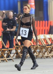 Hailey Baldwin added extra punch with a pair of black over-the-knee boots.