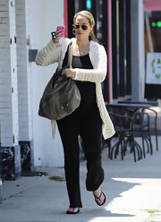 Elizabeth Berkley was seen out for lunch wearing a knit cardigan and some loose pants.