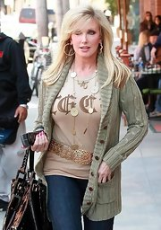 Morgan Fairchild went for a stroll in Beverly Hills looking casual yet chic in a beige shawl-collar cardigan and jeans.