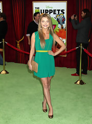 Izabella Miko was colorfully chic on the red carpet. She topped off her look with bronze pumps.