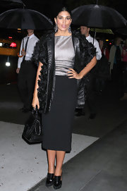 Rachel Roy added texture to her sleek style with a black embellished coat with leather lining.