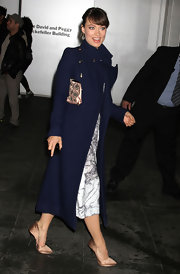 Olivia Wilde was ever the lady in a long wool navy coat with military styling.