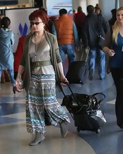 Naomi Judd wore quite the colorful pair of gaucho pants for a flight at LAX airport.