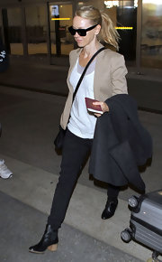 Naomi Watts strolled through LAX in black leather ankle boots with chunky wooden heels.