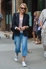 Naomi Watts kept it relaxed in loose capri jeans and a black blazer while out in New York City.