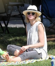 Naomi Watts spent some time under the sun wearing a pair of white-rimmed shades and a hat.