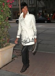 Natalie Cole chose this white trench with a sketch-print detailing for her look while out in Hollywood.