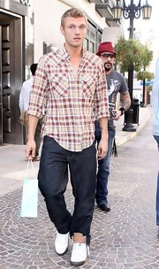 Nick Carter paired his classic dark jeans with a plaid button down shirt.