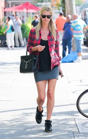 Nicky Hilton showed some skin in a gray mini skirt.