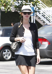 Nicky shopped trendy boutique Fred Segal in Hollywood, wearing a classic ensemble topped off with a straw fedora.