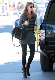 Nicky Hilton looked posh carrying a leather messenger bag by Mulberry. A chic striped tunic sweater gives her the perfect winter look for LA.