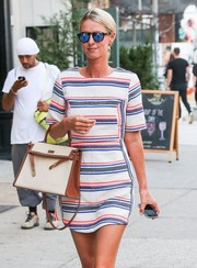 Nicky Hilton took a stroll in New York City wearing a pair of mirrored blue shades by Illesteva.