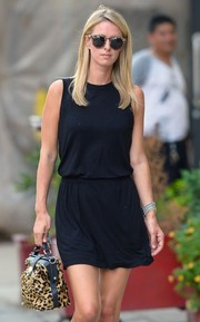Nicky Hilton's Illesteva sunnies coordinated well with her tote.